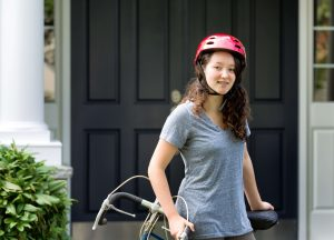 Smiling girl with braces riding a bike
