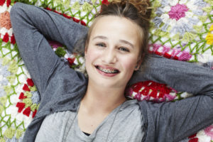 teen girl in braces relaxing