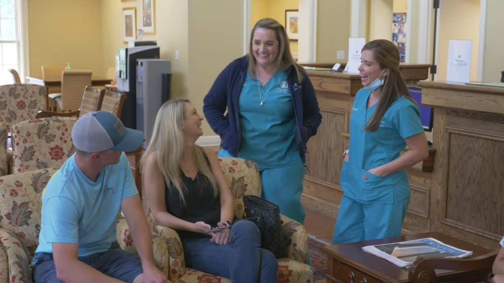 Bennett Orthodontics staff with a patient