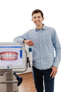 Dr. Zach Frazier, orthodontist in Downers Grove, with a 3D tooth scanner used for braces and Invisalign treatment.