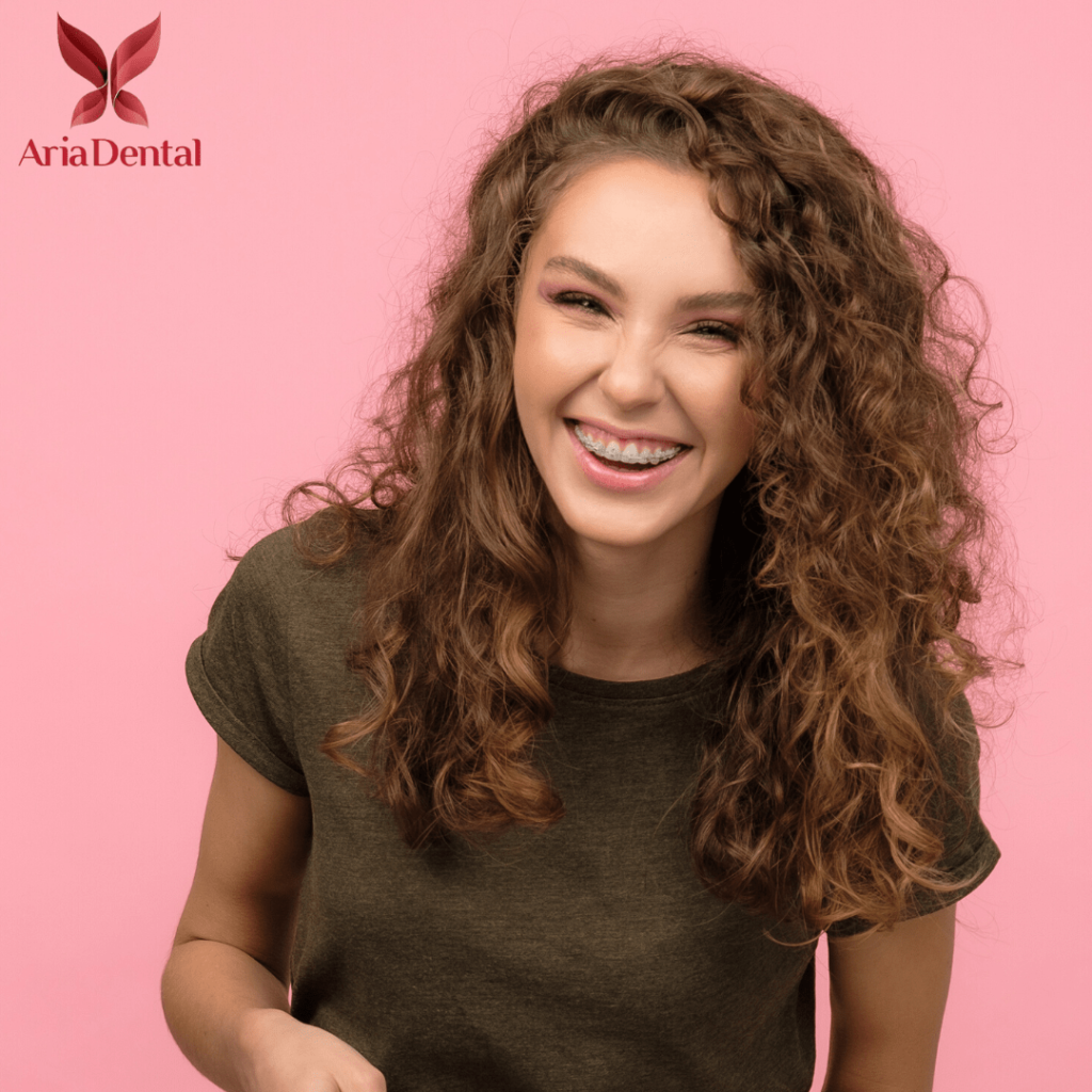 curly brown hair woman smiling