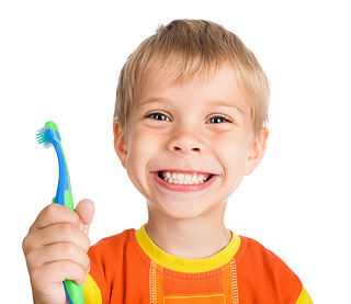 What kind of toothbrush and toothpaste should my child use?