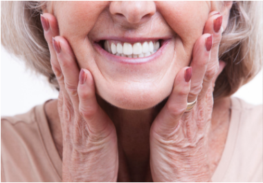 older woman smiling with dental implants